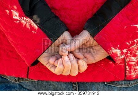 Wrinkled Senior Hands Behind The Back. Typical Posing