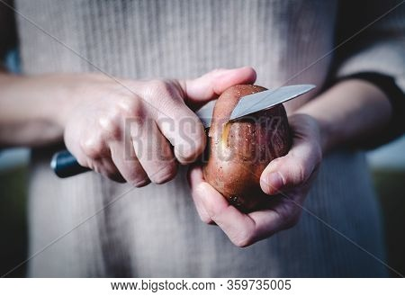 Close Up Of Hands Cutting Potato Food.  Healthy Food. Preparing Food. Nutritious Food. Woman Hands P