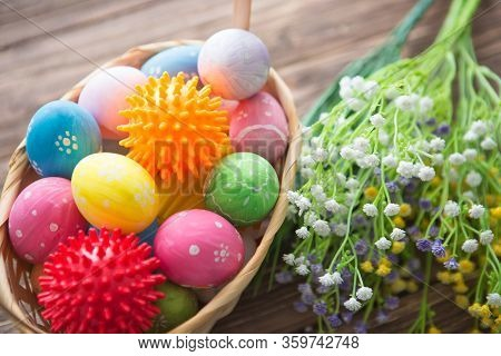 Virus Model Of Coronavirus Disease Covid-19 With Colorful Easter Eggs In Basket With Flowers On A Wo