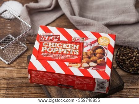 London, Uk - April 01, 2020: Box Of Chicken Poppers With Southern Fried Style Coating On Wood With P