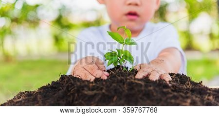 World Environment Day Environment And Save World Concept, Hand Of Asian Cute Cheerful Little Child B