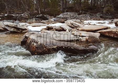 Mountain River On Background Of Rocks And Forest. Forest River Water Landscape. Wild River In Mounta