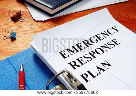 Open Blue Folder With Emergency Response Plan.