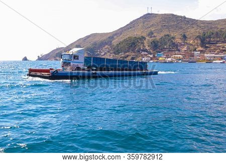 Bolivia Tiquina September 23 This Wooden Ferry Transports A Heavy Truk While Crossing The Strait Of