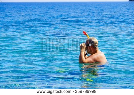 Man Diver With Snorkel Equipment Snorkeling Mask Tube In Ocean Water. Summer Vacation Swimming Fun C