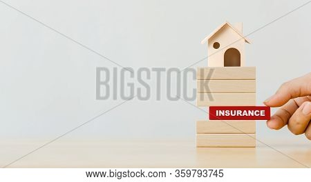Hand Putting Wooden Block With Word Insurance. Concept Of House Insurance
