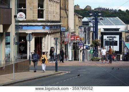 Huddersfield, Uk - July 10, 2016: People Visit Shopping Area In Huddersfield, West Yorkshire, Uk. Hu