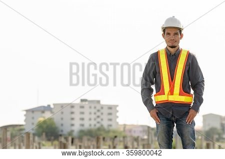 Handsome Construction Engineer Standing At The Construction Site