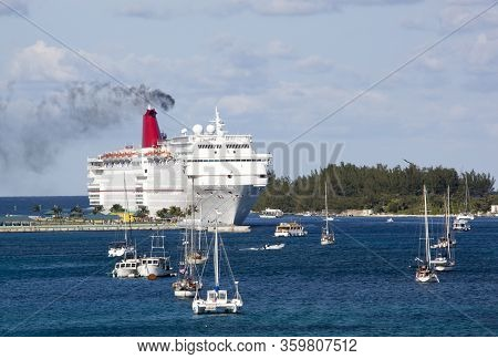 The Thick Smoke Coming Out Of Cruise Ship Moored In Nassau Harbour (nassau, Bahamas).