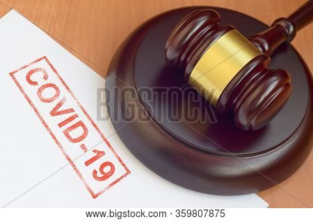 Justice Mallet And Blank Document With Covid-19 Red Stamp