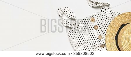 Summer Womens White Dress In Black Peas With Natural Wooden Buttons And Straw Hat On Light Gray Back