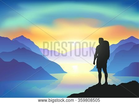 Hiker With Backpack On A Cliff Enjoy The Sunrise With Majestic Colorful Clouds Above The Mountain La