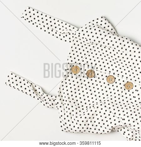 Summer Womens White Dress In Black Peas With Natural Wooden Buttons On Light Gray Background Flat La