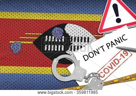 Swaziland Flag And Police Handcuffs With Inscription Dont Panic On White Paper. Coronavirus Or 2019-