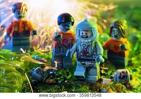 Magnitogorsk, Russia - September, 14 2019: Lego Zombies And A Very Scared Person In Hazmat Suit. Apo