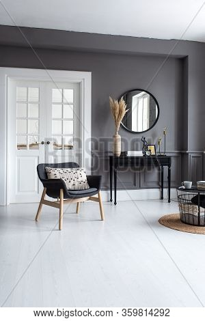 Modern Living Room Interior With Stucco Molding On The Walls With A Scandinavian-style Armchair, Con