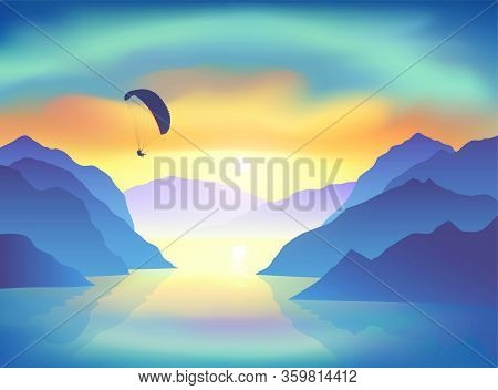Silhouette Of Flying Paraglider, Who Take A Selfie With Action Camera Above The Mountain Lake At Sun