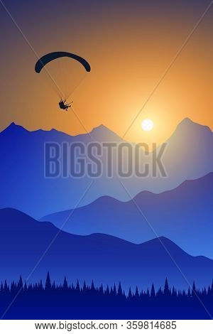 Silhouette Of Flying Paraglider Take A Selfie With Action Camera Above The High Mountains In A Light