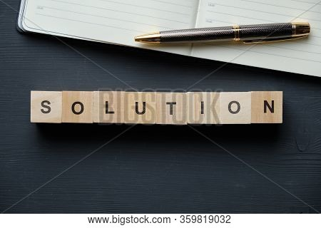 Modern Business Buzzword - Solution. Top View On Wooden Table With Blocks. Top View. Close Up.