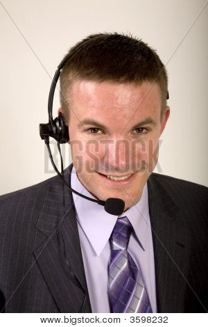 Smiling Businessman On A Headset