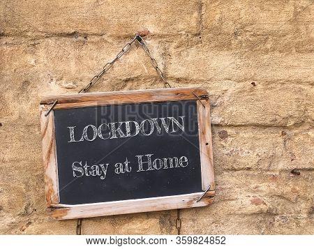 Blackboard With Coronavirus Lockdown And Stay At Home Text. Coronavirus (covid-19) Outbreak, Busines