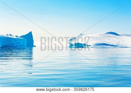 Big Blue Icebergs In The Ilulissat Icefjord, Western Greenland. Atlantic Ocean, Beautiful Seascape