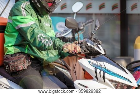 Bangkok, Thailand - April 05: Unnamed Grab Rider Makes A Deliver On A Motorcycle On Petchkasem 69 In