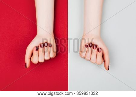 Red Manicure On Beautiful Accurate Womans Hands. Stylish Manicure And Social Distance Concept. Flat
