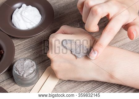 A Woman Puts A Finger Of Coffee Homemade Scrub On Her Hand. Spa, Beauty. Ingredients For Making A Sc