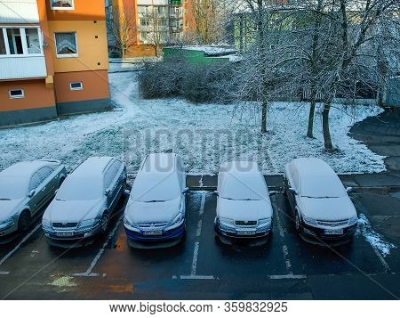 Chomutov, Czech Republic - March 31, 2020: Many Cars Parking In Street With Snow