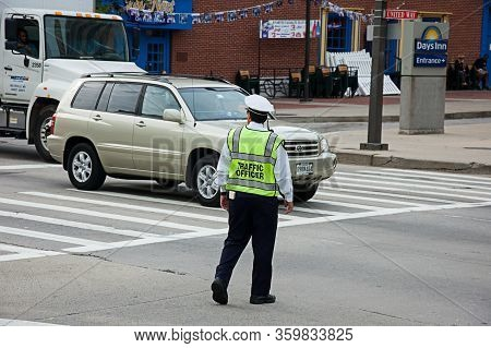 Baltimore, Md Usa September 9, 2008:  Traffic Officer In Downtown Baltimore Md Helps Reduce Risk Of