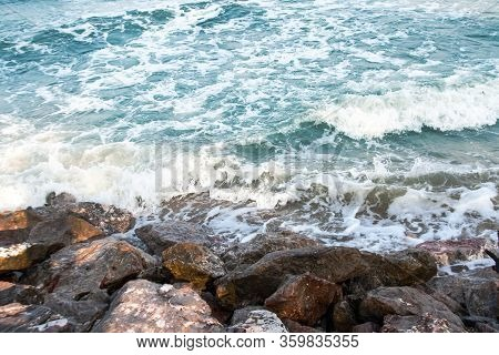 Blue Ocean Wave To The Rock With Foam On Island