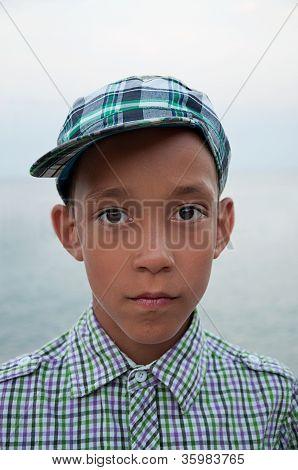 Sad Boy With Brown Eyes In Cap