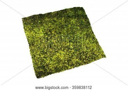 Closeup Sheet Of Dried Crispy Seaweed Texture. Piece Of Crispy Seaweed Asian Food Isolated On White
