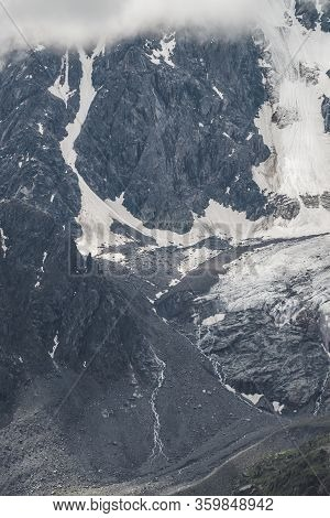 Atmospheric Minimalist Textured Alpine Landscape Of Snowy Rocky Mountain With Glacier Tongue. Backgr