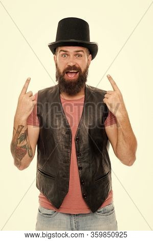 Old Fashioned And Vintage. Caucasian Guy Pointing At Vintage Top Hat Accessory Or Headgear. Bearded