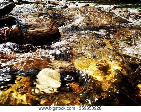 Water Glides Over Stones In Nature Water Glides Over Stones In Nature