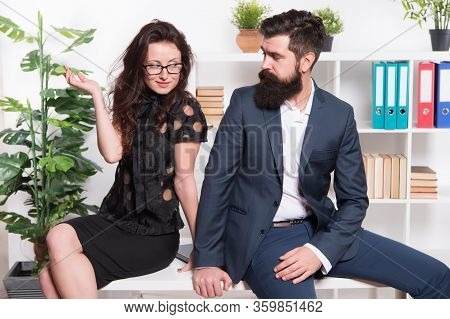 Table Top Review. Business Couple Sit On Office Desk. Staff Meeting. Formal Meeting. Bearded Man And