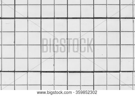 Minimalist Background Of White Tiled Building Wall. Square Tiles On House Side Close-up. Backdrop Of