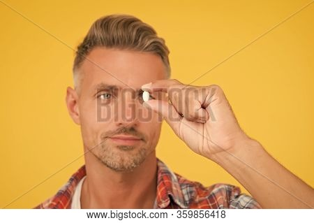Unshaven Man Hold Vitamin Pill, Selective Focus. Medicine Concept. Anabolic And Steroids. Food Addit