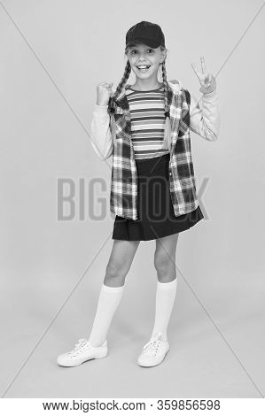 Hipster In Pigtails. Happy Little Hipster Wear Baseball Cap Yellow Background. Cute Small Hipster Sm