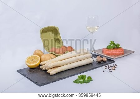 Delicious Seasonal White Asparagus With Creamy Hollandaise Sauce, Baby Boiled Potatoes And Sliced Sm