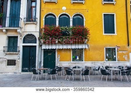 Empty Tables Of Sidewalk Cafe, Venice, Italy