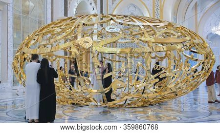 Abu Dhabi, Uae - December 15, 2019: People Walking Near Sculptural Composition The Power Of Words In