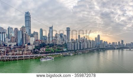 Chongqing, China - Dec 22, 2019: Sunset Over Jialing River With Dense Residence Buiding