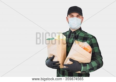 Safe Food Delivery During Quarantine And Outbreak Caused Coronavirus. Young Deliveryman Wearing Prot