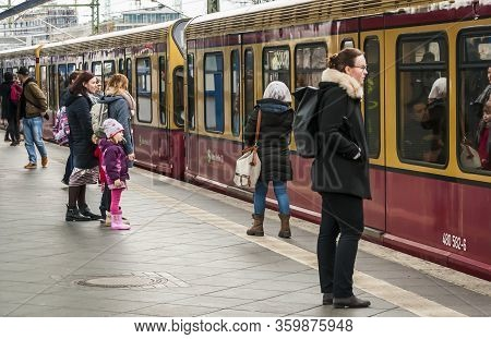 Berlin, Germany. February 16, 2020. Traditional Yellow Red S-bahn City Trains In Berlin Arriving To