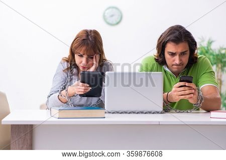 Two students in gadget dependency concept