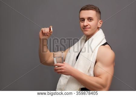 Trainer Takes A Pill Of Amino Acids After Training