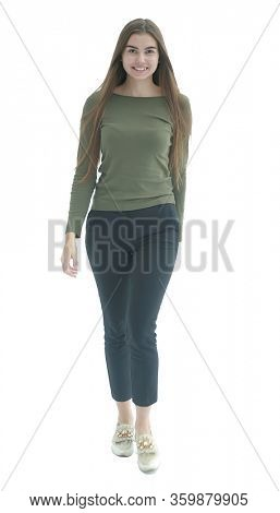 in full growth. confident young woman striding forward